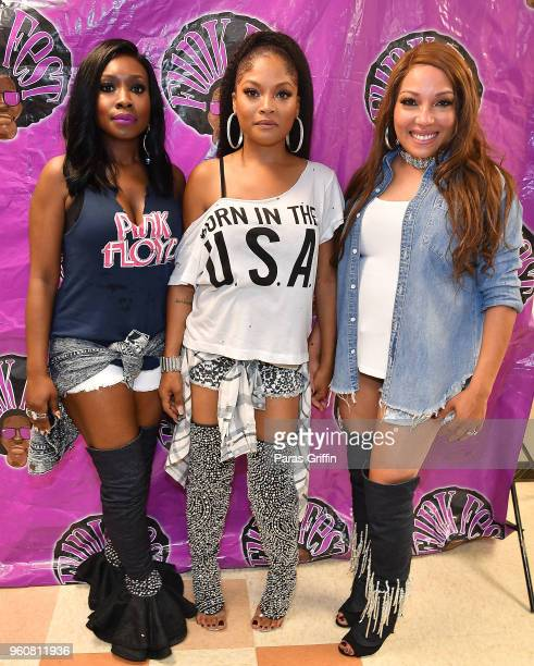 Singers Kameelah Williams Irish Grinstead and LaMisha Grinstead of 702 attend 2018 Funk Fest Tour at Wolf Creek Amphitheater on May 20 2018 in...