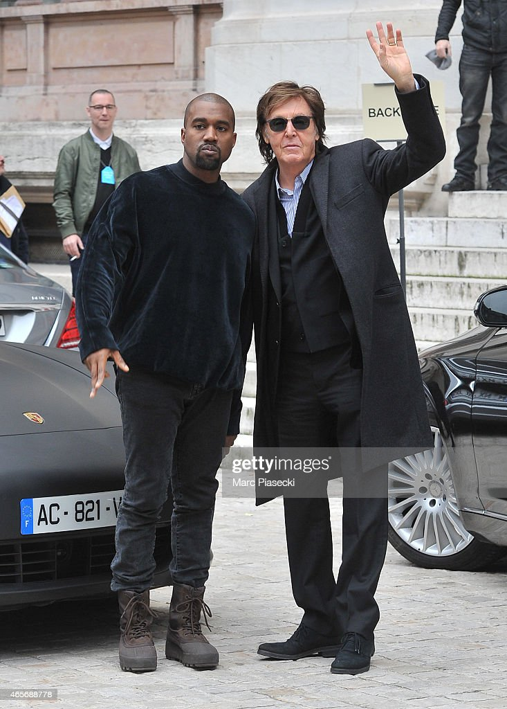 Singers Kanye West and Paul McCartney pose ahead the Stella McCartney fashion show at Opera Garnier on March 9, 2015 in Paris, France.