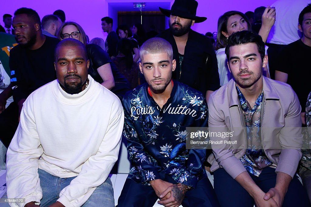 Singers Kanye West, Zayn Malik and Joe Jonas attend the Louis Vuitton Menswear Spring/Summer 2016 show as part of Paris Fashion Week on June 25, 2015 in Paris, France.
