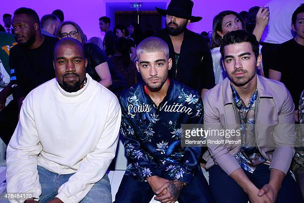Singers Kanye West Zayn Malik and Joe Jonas attend the Louis Vuitton Menswear Spring/Summer 2016 show as part of Paris Fashion Week on June 25 2015...