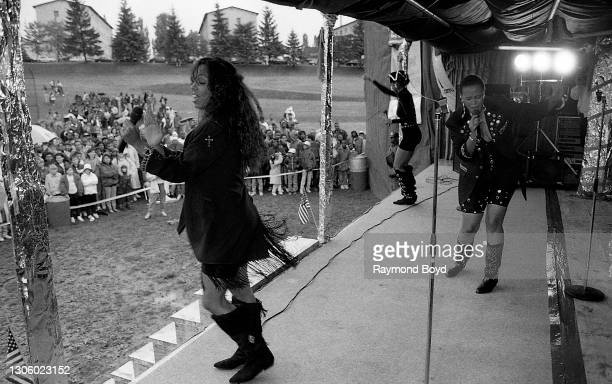 Singers Kathy Merrick, Lisa Frazier and Vivian Ross of Lace performs on an army base during the V-103 FM Chicago USO Trans-Atlantic Jam in Pirmasens,...