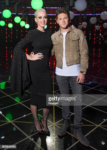 SYDNEY NSW Singers Katy Perry and Niall Horan pose during a photo shoot on stage at 'The Voice' in Sydney New South Wales
