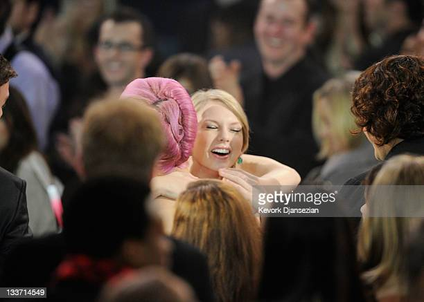 Singers Katy Perry and Taylor Swift embrace at the 2011 American Music Awards held at Nokia Theatre LA LIVE on November 20 2011 in Los Angeles...