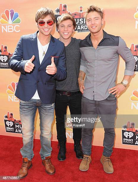 Singers Keaton Stromberg Wesley Stromberg and Drew Chadwick of Emblem3 arrive at the 2014 iHeartRadio Music Awards at The Shrine Auditorium on May 1...