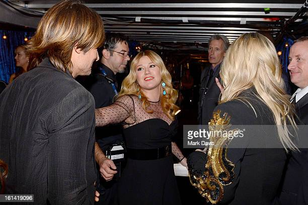 Singers Keith Urban and Kelly Clarkson and actress Kaley Cuoco attend the 55th Annual GRAMMY Awards at STAPLES Center on February 10 2013 in Los...