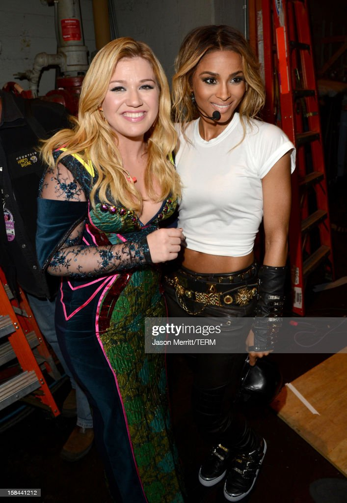 Singers Kelly Clarkson (L) and Ciara backstage at 'VH1 Divas' 2012 held at The Shrine Auditorium on December 16, 2012 in Los Angeles, California.