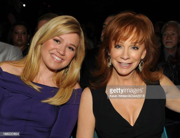 Singers Kelly Clarkson and Reba McEntire pose in the audience during the 48th Annual Academy of Country Music Awards at the MGM Grand Garden Arena on...
