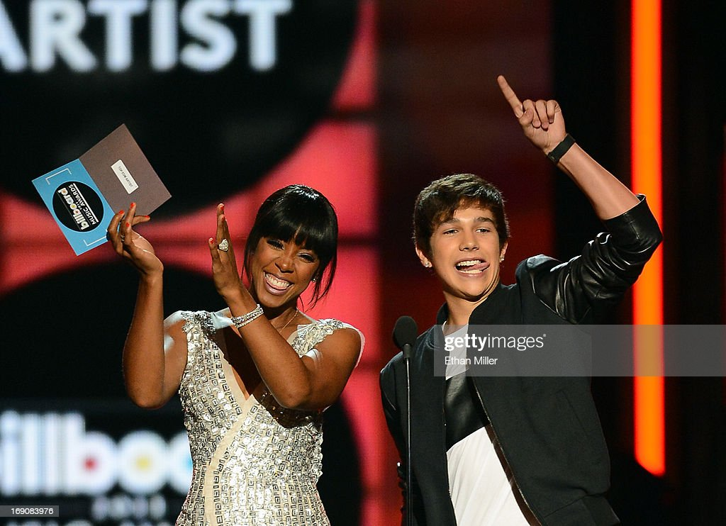 Singers Kelly Rowland (L) and Austin Mahone present the award for Top EDM Artist onstage during the 2013 Billboard Music Awards at the MGM Grand Garden Arena on May 19, 2013 in Las Vegas, Nevada.