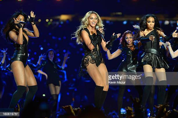 Singers Kelly Rowland Beyonce and Michelle Williams of Destinys Child perform during the Pepsi Super Bowl XLVII Halftime Show at MercedesBenz...