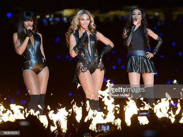 Singers Kelly Rowland Beyonce and Michelle Williams of Destiny's Child perform during the Pepsi Super Bowl XLVII Halftime Show at MercedesBenz...
