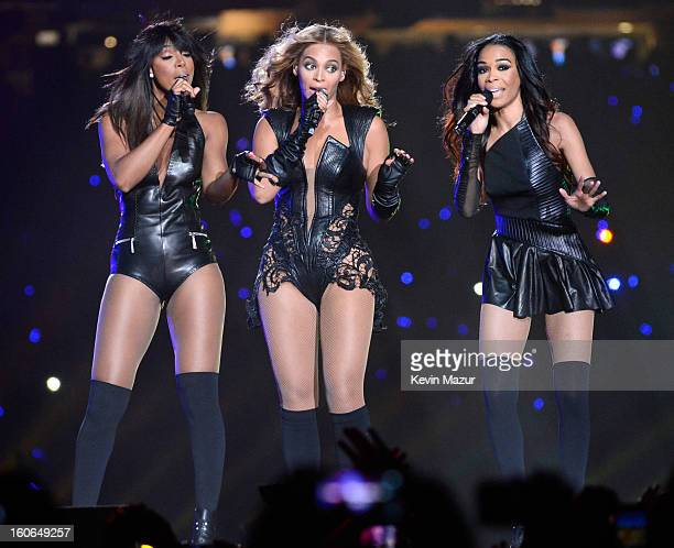 Singers Kelly Rowland, Beyonce and Michelle Williams of Destiny's Child perform during the Pepsi Super Bowl XLVII Halftime Show at Mercedes-Benz...