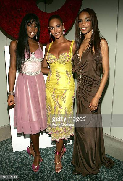 Singers Kelly Rowland Beyonce Knowles and Michelle Williams of Destiny's Child pose for a photo at the Beyonce Beyond the Red Carpet auction...