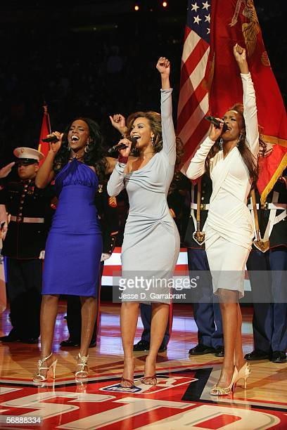 Singers Kelly Rowland Beyonce Knowles and Michelle Williams of the group Destiny's Child perform the National Anthem prior to the 2006 NBA AllStar...