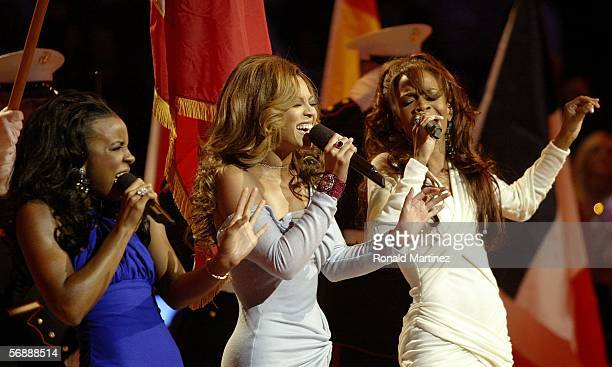 Singers Kelly Rowland Beyonce Knowles and Michelle Williams of the group Destiny's Child perform the National Anthem at the AllStar game during the...