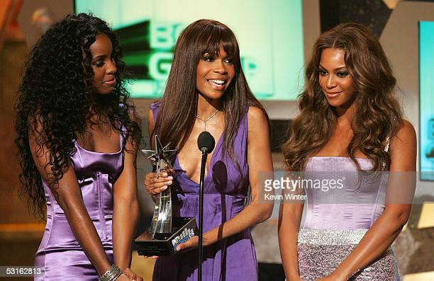 Singers Kelly Rowland Michelle Williams and Beyonce Knowles of Destiny's Child accept the award for Best Group onstage at the BET Awards 05 at the...