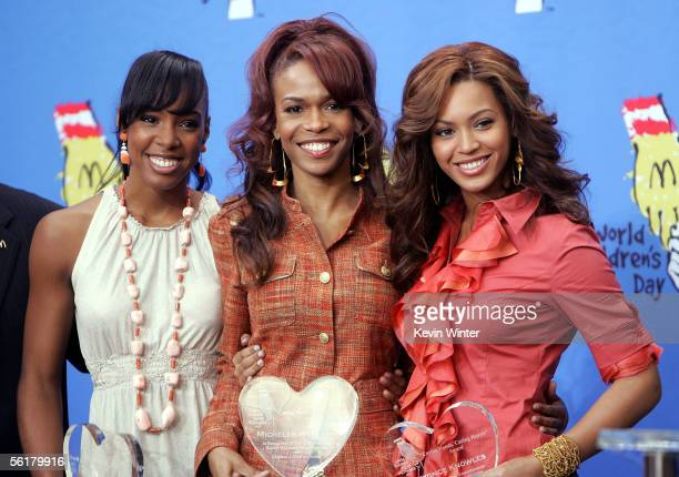 Singers Kelly Rowland Michelle Williams and Beyonce Knowles of Destiny's Child pose with their award at the 2005 World Children's Day at the...