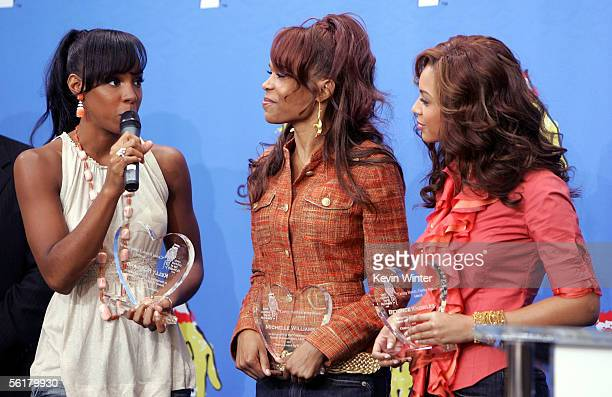 Singers Kelly Rowland Michelle Williams and Beyonce Knowles of Destiny's Child speak onstage with their awards at the 2005 World Children's Day at...