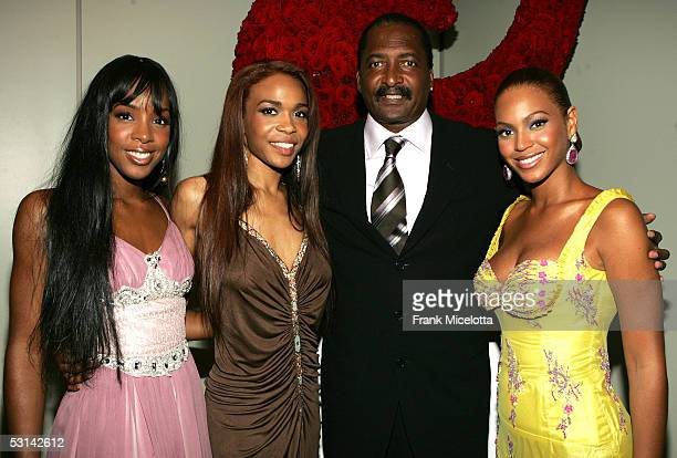 Singers Kelly Rowland Michelle Williams and Beyonce Knowles pose with their manager Matthew Knowles at the Beyonce Beyond the Red Carpet auction...