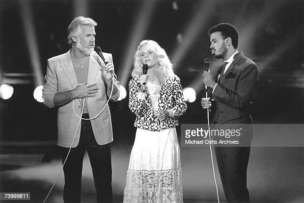 Singers Kenny Rogers Kim Carnes and James Ingram performing on Solid Gold in September 1984 in Los Angeles