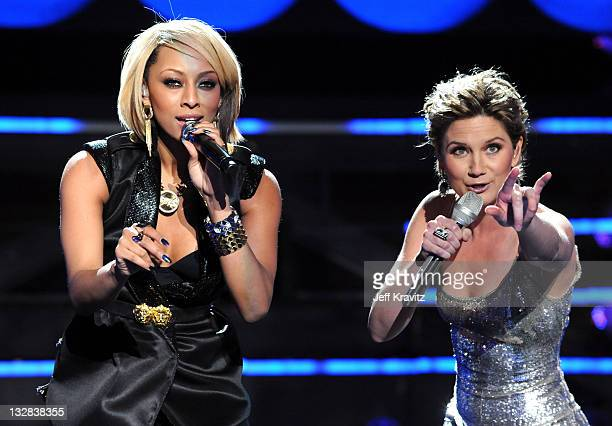 Singers Keri Hilson and Jennifer Nettles perform onstage during 'VH1 Divas Salute the Troops' presented by the USO at the MCAS Miramar on December 3...