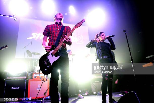 Singers Kevin Bivona and Aimee Allen of the band The Interrupters performs onstage during the Strange 80's concert at The Fonda Theatre on October 12...