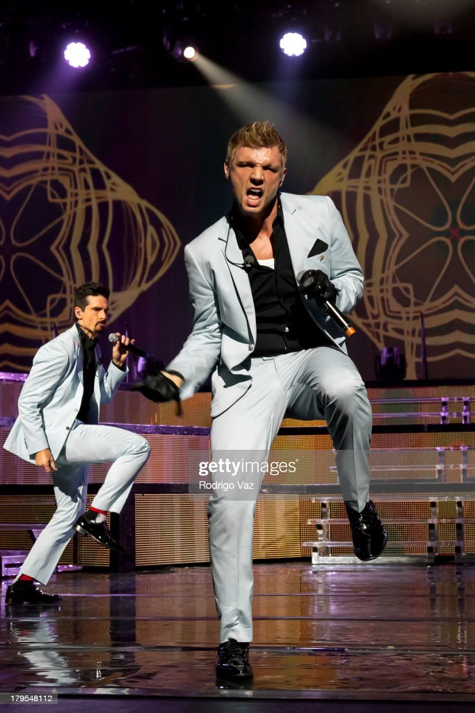 Singers Kevin Richardson (L) and Nick Carter of Backstreet Boys perform at Backstreet Boys In Concert at Gibson Amphitheatre on September 4, 2013 in Universal City, California.