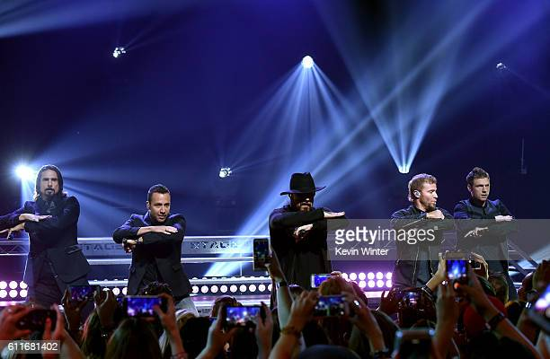 Singers Kevin Richardson Howie Dorough A J McLean Brian Littrell and Nick Carter of Backstreet Boys perform live on the Honda Stage at the...