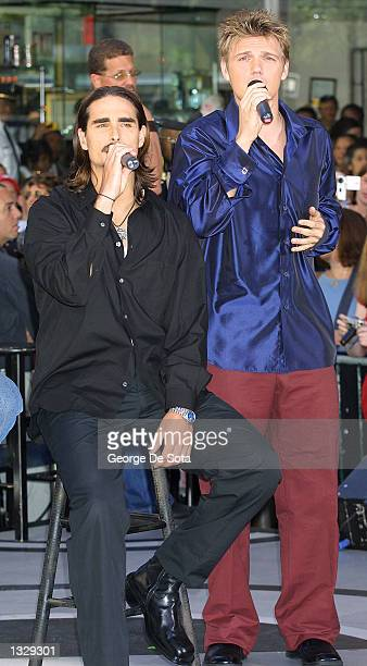 Singers Kevin Richardson left and Nick Carter of the Backstreet Boys perform July 2 2001 on the Today Show at Rockefeller Plaza in New York City