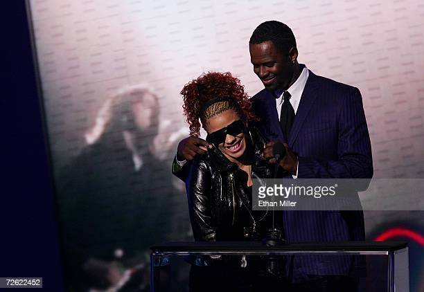 Singers Keyshia Cole and Brian McKnight present the award for Contemporary Inspirational Artist onstage at the 2006 American Music Awards held at the...