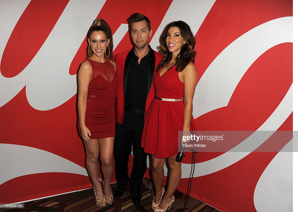 Singers Kimberly Cole, Lance Bass, and TV personality Adrianna Costa pose during the 40th Anniversary American Music Awards nominations press conference at the JW Marriott Los Angeles at L.A. LIVE on October 9, 2012 in Los Angeles, California.