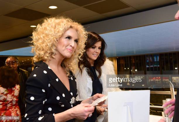 Singers Kimberly Schlapman and Karen Fairchild of musical group Little Big Town attend the GRAMMY Gift Lounge during the 60th Annual GRAMMY Awards at...