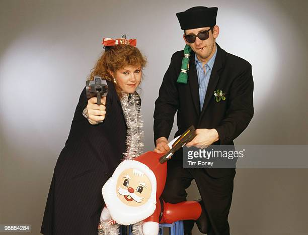 Singers Kirsty MacColl and Shane MacGowan with toy guns and an inflatable Santa in a festive scenario circa 1987 In 1987 the pair collaborated on the...