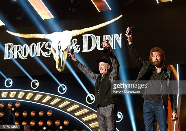 Singers Kix Brooks and Ronnie Dunn accept the 'Nash Icon' award onstage during the 2016 American Country Countdown Awards at The Forum on May 1 2016...