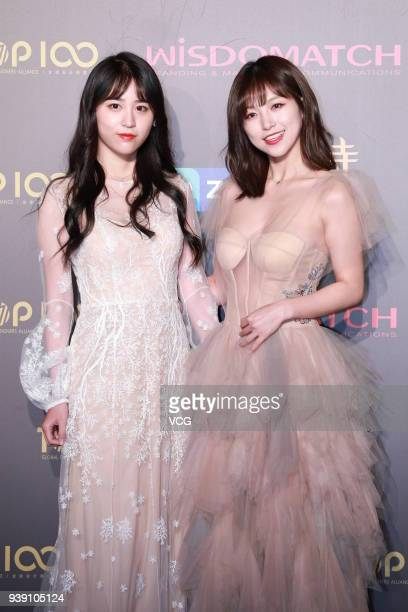 Singers Kong Xiaoyin and Qian Beiting of SNH48 girl group arrive at the Top 100 Fashion On The Bund event during the Shanghai Fashion Week...