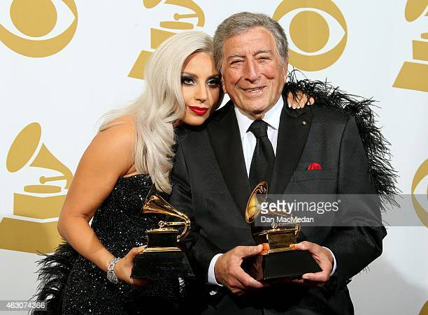 Singers Lady Gaga and Tony Bennett winners of Best Traditional Pop Vocal Album for 'Cheek to Cheek' pose in the press room at The 57th Annual GRAMMY...