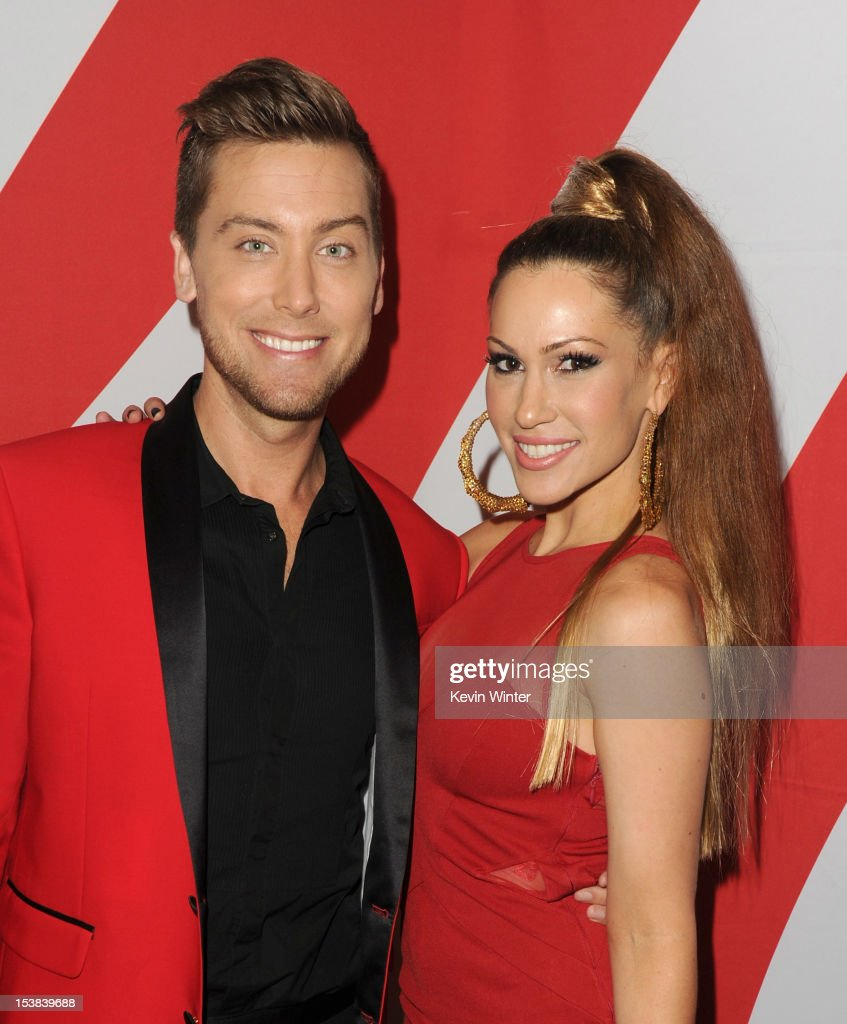 Singers Lance Bass (L) and Kimberly Cole pose during the 40th Anniversary American Music Awards nominations press conference at the JW Marriott Los Angeles at L.A. LIVE on October 9, 2012 in Los Angeles, California.