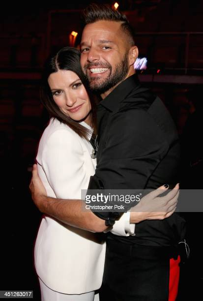 Singers Laura Pausini and Ricky Martin pose backstage during the 14th Annual Latin GRAMMY Awards held at the Mandalay Bay Events Center on November...
