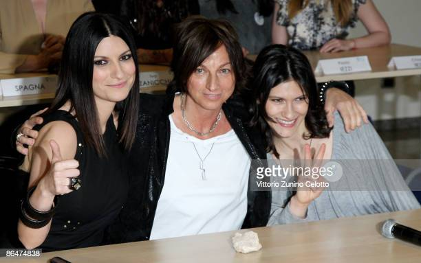 Singers Laura Pausini Gianna Nannini Elisa pose during the 'Friends For Abruzzo' Press Conference on May 7 2009 in Milan Italy