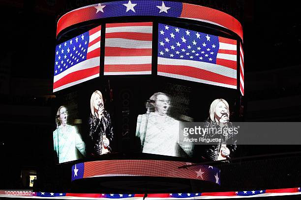 Singers Lauren Hart and Kate Smith are seen on the screen before Game Six of the 2010 NHL Stanley Cup Final between the Chicago Blackhawks and the...