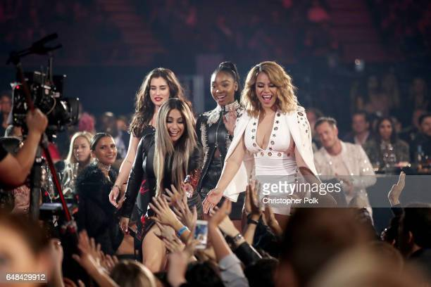 Singers Lauren Jauregui Ally Brooke Normani Kordei and Dinah Jane of music group Fifth Harmony react during the 2017 iHeartRadio Music Awards which...