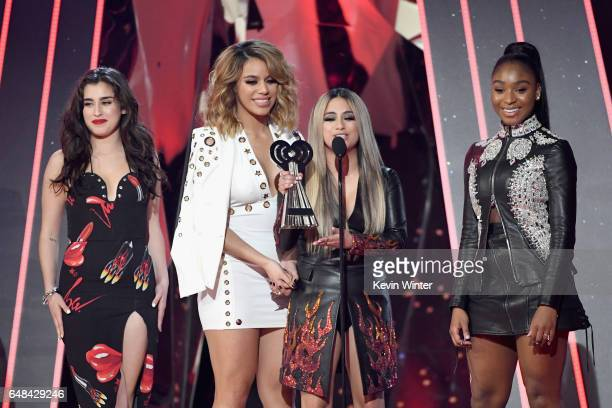 Singers Lauren Jauregui Dinah Jane Ally Brooke and Normani Kordei of Fifth Harmony accept Best Fan Army onstage at the 2017 iHeartRadio Music Awards...