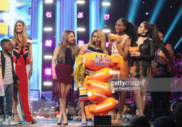 Singers Lauren Jauregui, Dinah Jane Hansen, Normani Kordei and Ally Brooke of Fith Harmony accept the award for Favorite Music Group from presenter...