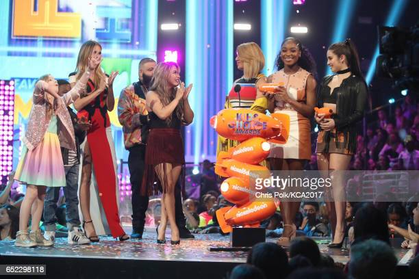 Singers Lauren Jauregui, Dinah Jane Hansen, Normani Kordei and Ally Brooke of Fith Harmony accept the award for Favorite Music Group from presenters...