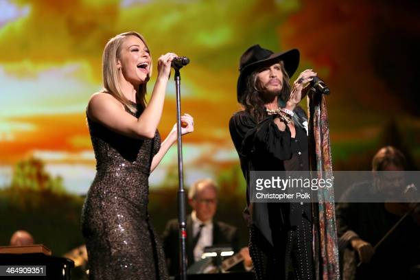 Singers LeAnn Rimes and Steven Tyler perform onstage at 2014 MusiCares Person Of The Year Honoring Carole King at Los Angeles Convention Center on...