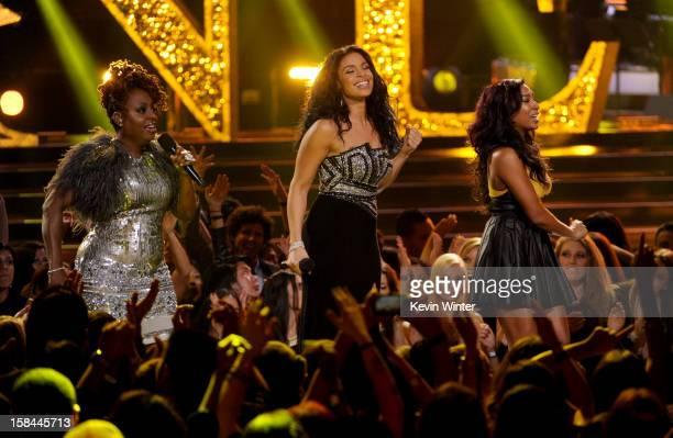 Singers Ledisi Jordin Sparks and Melanie Fiona perform onstage during 'VH1 Divas' 2012 at The Shrine Auditorium on December 16 2012 in Los Angeles...