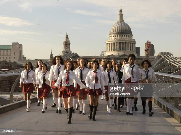 Singers Lena Katina and Julia Volkova from the girl band tATu are shown on the set of the duo's upcoming music video May 7 2003 in Central London