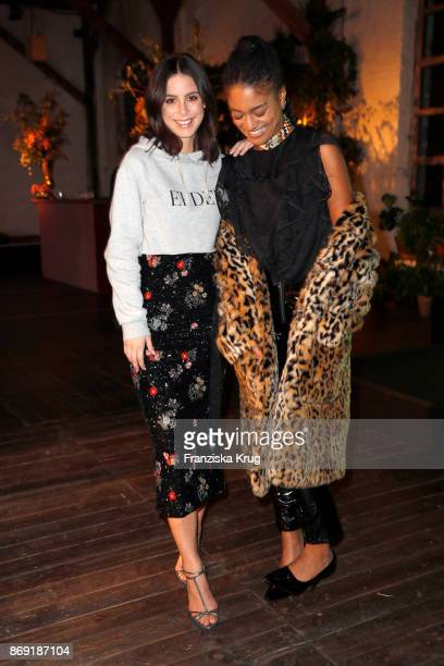 Singers Lena MeyerLandrut and Lary wearing ERDEM X HM attend the ERDEM x HM PreShopping Event on November 1 2017 in Berlin Germany