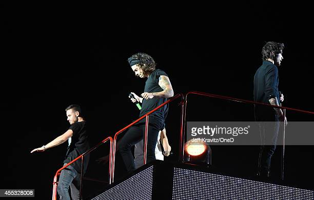 Singers Liam Payne Harry Style and Zayn Malik of One Direction perform onstage during the One Direction' Where We Are' Tour at Rose Bowl on September...