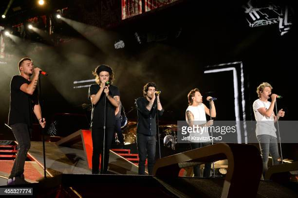 Singers Liam Payne Harry Styles Zayn Malik Louis Tomlinson and Niall Horan of One Direction perform onstage during the One Direction Where We Are...