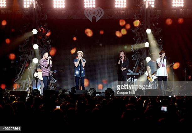 Singers Liam Payne Niall Horan Harry Styles and Louis Tomlinson of One Direction perform onstage during 1061 KISS FM's Jingle Ball 2015 presented by...